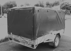 Trailer cover using green PVC.